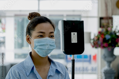 The Asian tourist woman has checked body temperature with a thermal Temperature Canvas Print