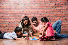 Indian Happy Family Playing Bo...