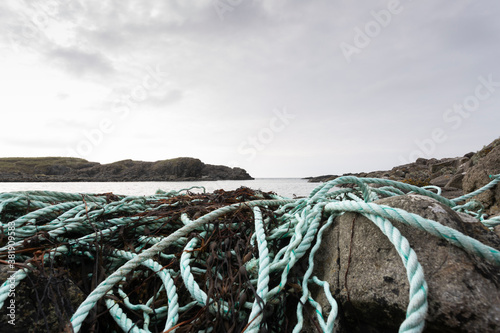 Debris from fishing industry washed up on rocks, nylon and plastic rope and nett Canvas Print