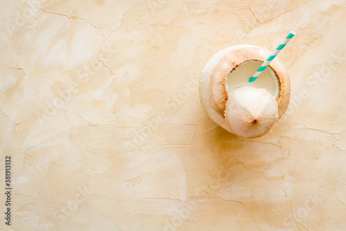 Green coconuts with drinking straw - tropical cocktail, above view