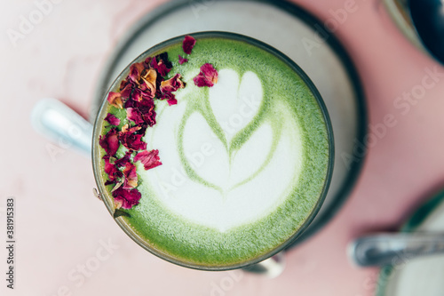 Fotomural Glass of Super Latte such as Rose Matcha from Organic Japanese green tea powder infused with rose water