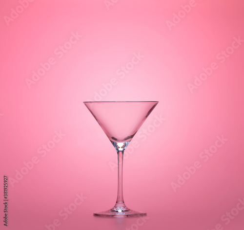 empty martini cup isolated on pastel pink background