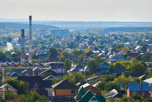 Small town with houses, factories and trees top view. Fototapeta