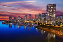 Skyline Of Apartments In Vancouver With Red Sunset Sky At Dusk