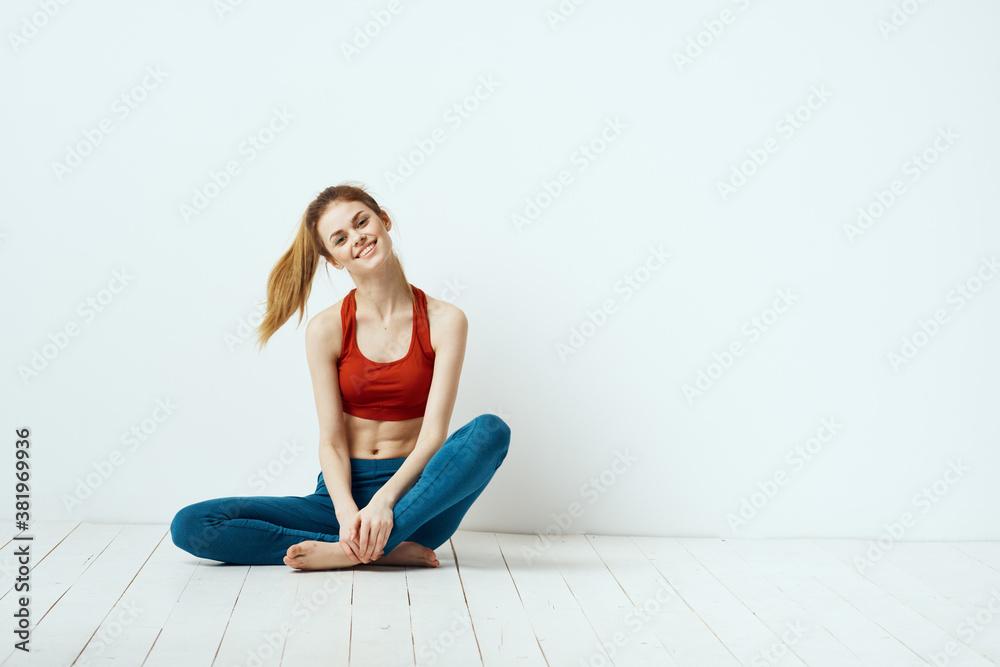 Fototapeta Sportive woman pose gymnastics balance exercise light background