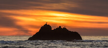 A Rock Outcropping At Sunset, ...