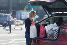 Woman Loading Groceries Into B...