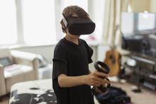 Boy Playing Video Game With VR...
