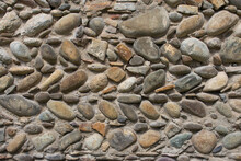 Old Stone Wall. Wall Of Medieval House. Antique Architecture Details. Decorative Design Of Ancient Building Facade. Granite And Pebbles In The Wall. Stones Concept Wallpaper.
