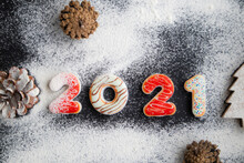 New Years Concept - Gingerbread Cookies With 2021 Number-shaped Icing, Floured To Simulate Snow. Banner, Poster, Postcard.