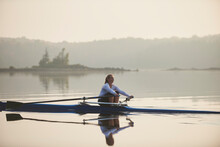 Middle Aged Woman Rowing On Ca...