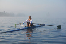 Middle Aged Woman Rowing On La...