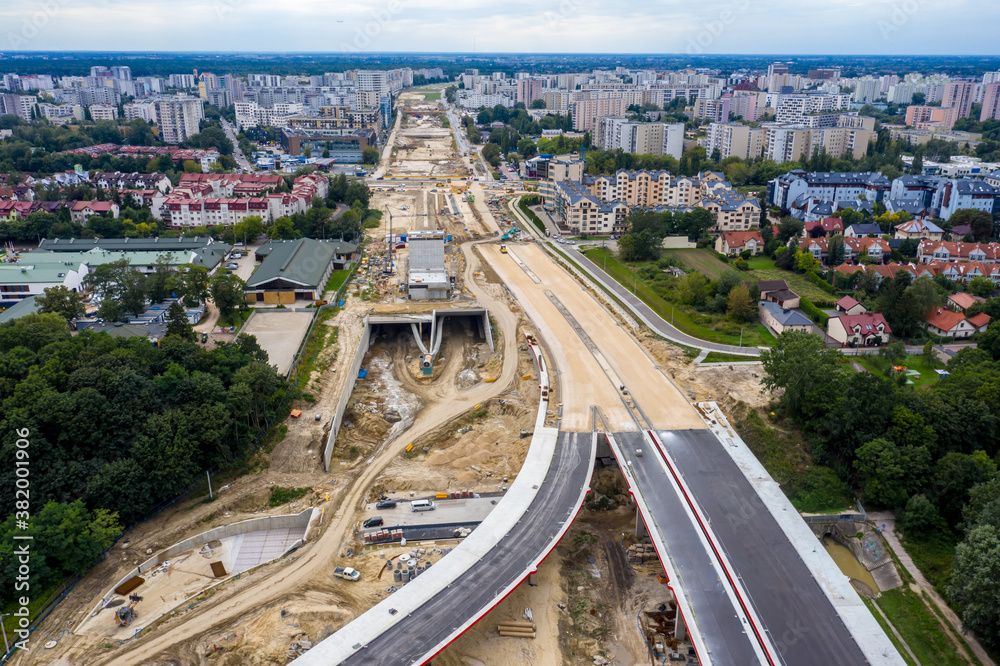 Fototapeta aerial top view of road construction site. building of new city highway. drone image. new road construction site