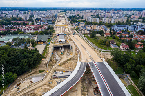 Fototapeta aerial top view of road construction site. building of new city highway. drone image. new road construction site obraz