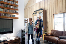 Couple Arriving In Vacation Home