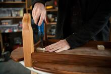 Male Carpenter Assembling Furn...