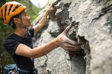 Young Man In Helmet Rock Climb...