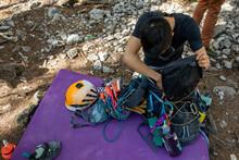 Young Man Preparing Rock Climbing Equipment