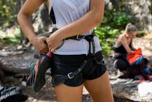 Close Up Young Woman Preparing Rock Climbing Harness