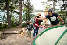 Happy Family Pitching Tent At ...