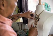 Jewelry Maker Working On Neckl...