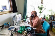 Man On Phone Loading Up Jewelr...