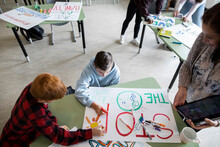 Students Making Poster In Class