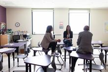 Teachers Talking In Class On Break