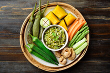 Northern Thai Food (Nam Prik Num), Spicy Young Green Chili Dip Eating With Boiled Vegetables, Fresh Vegetables And Pork Rind, Local Thai Food