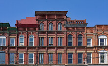 Facade Of Ornately Designed Row Of Old 19th Century Brick Buildings