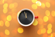Cup With Clock On Color Backgr...