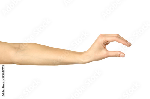 Fotomural Measuring invisible item. Woman hand gesturing isolated on white
