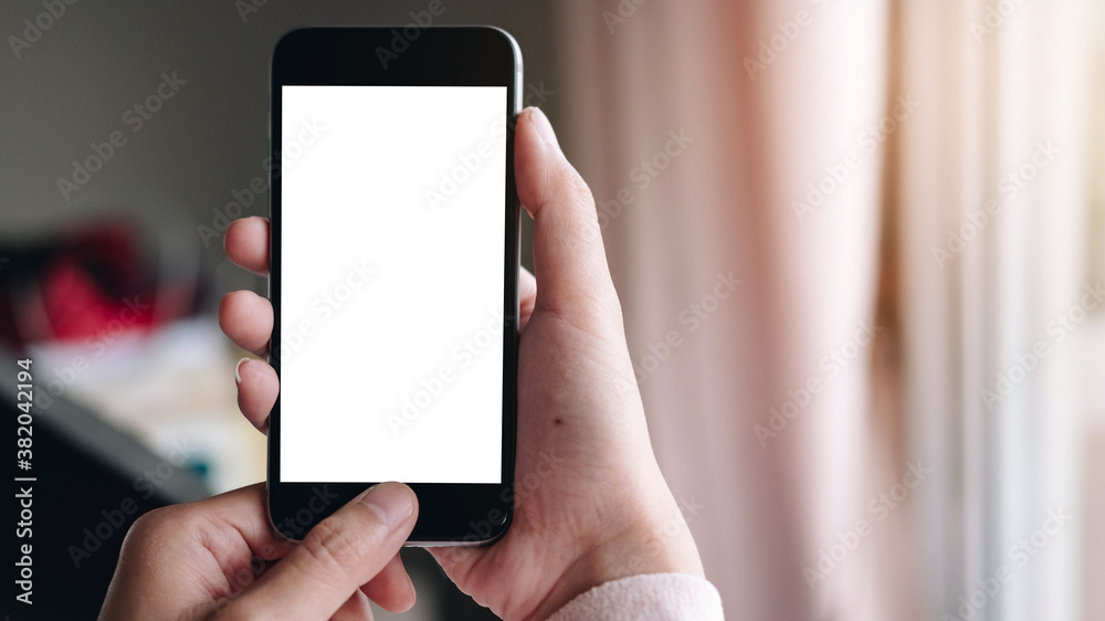 Fototapeta Close up Woman hand Using a Smart Phone with blank screen at home