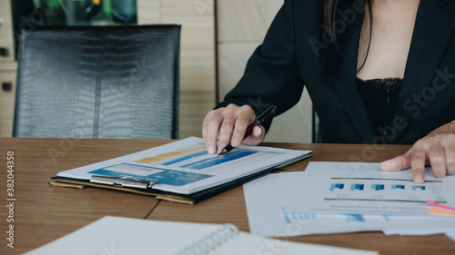 Fototapeta Business man investment consultant analyzing company annual financial report balance sheet statement working with documents graphs. Concept picture of business, market, office, tax. obraz