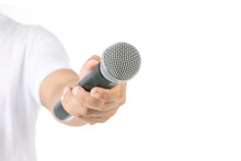 People Holding Black Wireless Microphone In Studio. Isolated On White