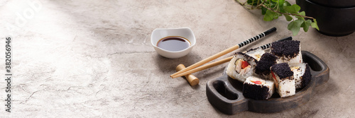 Fototapeta Japanese sushi food. Top view of sushi. Rolls with masaga caviar. Still life. Unusual composition of rolls. obraz