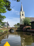 Canoeing through the town oosthem in Friesland