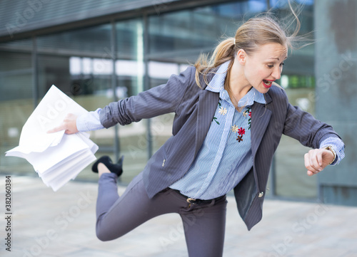 Portrait of busy female in suit rushing to important meeting Canvas Print