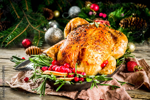 Fotografie, Obraz Roasted whole chicken with Christmas decoration