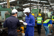 Multiethnic Worker, Supervisor Wearing Mask In Manufacturing Factory On Business Day. African Industrial Engineers Have To Consult With Colleagues While Using Machine. New Normal, Epidemic Prevention