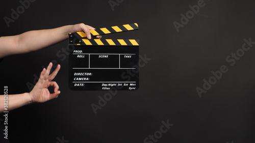 hands is holding clapper board or movie slate Fototapet