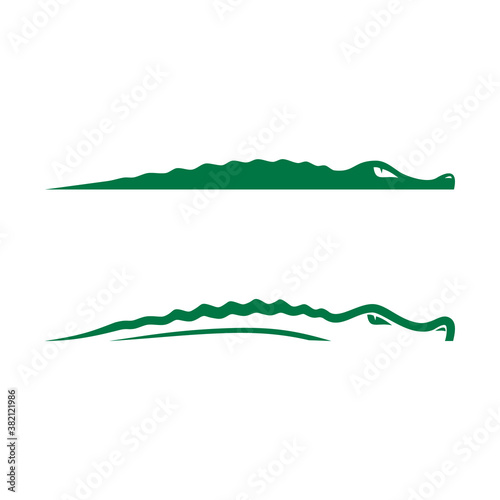 Photographie the logo of a swimming crocodile