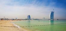 DUBAI, UAE - MARCH 30, 2017: The Evening Skyline With The Burj Al Arab And Jumeirah Beach Hotels And The Open Jumeriah Beach.