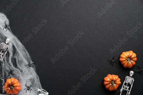 Slika na platnu Mystery Halloween background with pumpkins, spiderwebs, skeletons, spiders on black table
