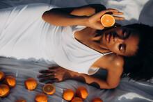 Dark-skinned Model Lies On Whi...