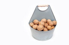 Walnuts In A Bucket On A White Background