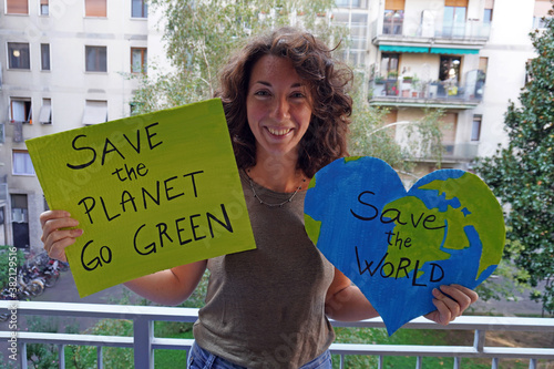 Outdoor portrait of caucasian young woman activist with Save the Planet, World e Canvas Print