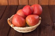 Freshly Picked Tomatoes On A Dark Wooden Background.