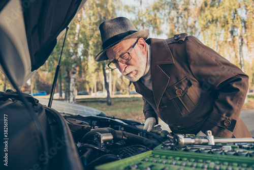 Photo of retired old man look motor examination problem automobile fixing wear b Fototapeta