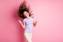 Portrait Of Young Funky Lady Show V-sign Flowing Hair Wear Casual Isolated On Pink Color Background